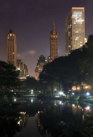 Central Park on a misty foggy night in New York City.   taken at the pond near 59th street and Columbus avenue.    photo