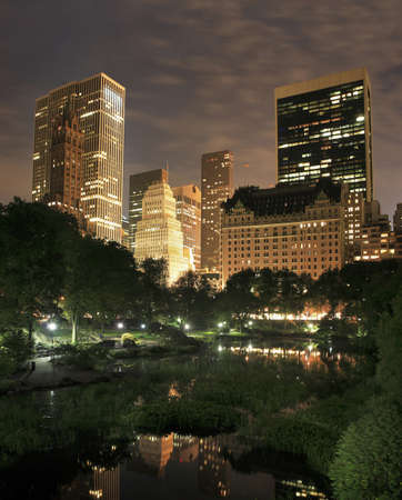 Central Park at night in New York City.  taken at the pond near 59th street and Columbus avenue.    Stock Photo