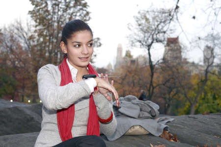 Girl with communication device Stock Photo - 10315456