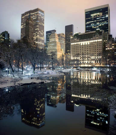 New York City buildings as viewed from Central Park at night.