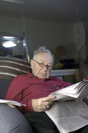 Senior reading paper .  He is Romanian born and  Jewish.  He is 85 years old.     Stock Photo - 10314827