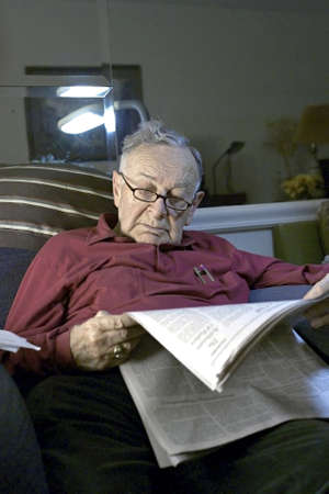 Senior reading paper  on sofa.  He is Romanian born and  Jewish.  He is 85 years old.     Stock Photo - 10314825