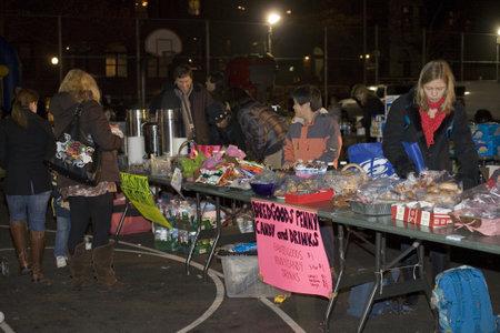 NEW YORK, NEW YORK - NOVEMBER 24: vendors during inflation of Macys balloons night before parade. Taken November 24, 2010 in New York City.