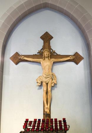 Figure of Jesus on Cross inside Church. Redakční