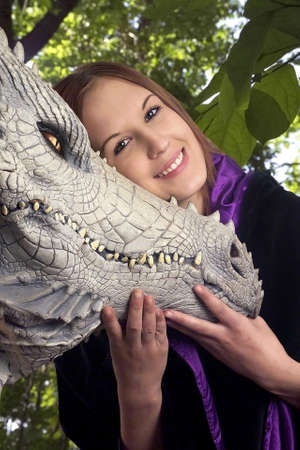 Teenage girl with her pet dragon.  She was 17 at time of shoot.