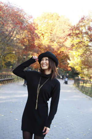 Fashion model poses in Central Park New York.  She was 23 at the time of shoot and of Japanese ethnicity.  Photographed November, 2007. Stock Photo - 10328859