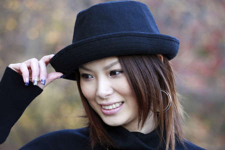 Fashion model poses in Central Park New York.  She was 23 at the time of shoot and of japanese ethnicity.  Photographed November, 2007.             photo