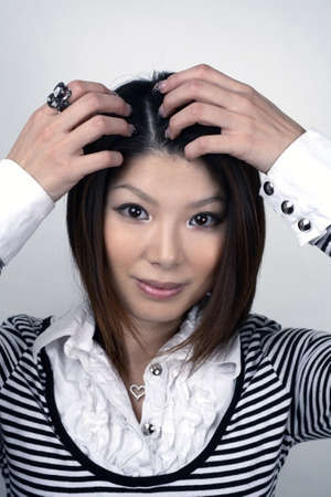 scalp: She is Japanese and was in her early twenties at the time of shoot.  Photographed December, 2007, USA.