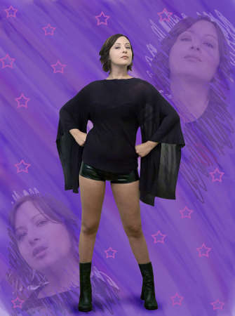 superheroine: Girl against purple background .  She is Irish American, was in her twenties at the time of shoot.  Stock Photo