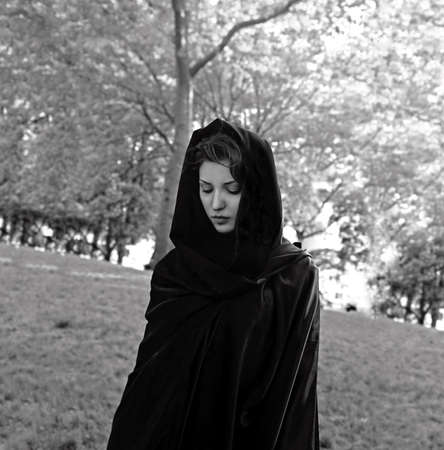 jewish: Girl wears a dark cloak in Central Park, New York City, USA.  She is Jewish American.  Photographed June, 2007.   Stock Photo