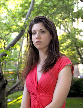 Girl sits in Central Park thinking.  She was in her twenties at the time of shoot and is Jewish american.  Photographed June, 2007 in the USA. Stock Photo - 10328824
