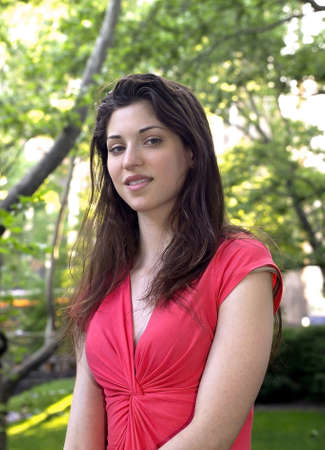 Lady in red photographed June, 2007 in Central Park, New York in the USA.  She was in her twenties at the time of shoot and Jewish American.   Stock Photo