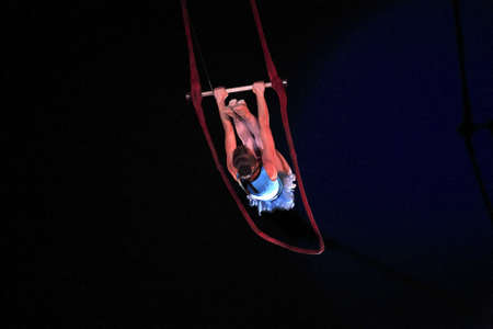 trapeze: NEW YORK, NEW YORK - NOVEMBER 15: Woman on trapeze performs during Big Apple Circus show.  Taken November 15, 2007 in New York City.