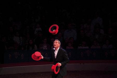 NEW YORK, NEW YORK - NOVEMBER 15: Man performs hat tricks during Big Apple Circus show.  Taken November 15, 2007 in New York City.