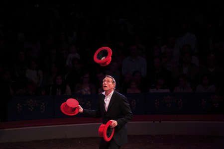 NEW YORK, NEW YORK - NOVEMBER 15: Man performs hat tricks during Big Apple Circus show.  Taken November 15, 2007 in New York City.