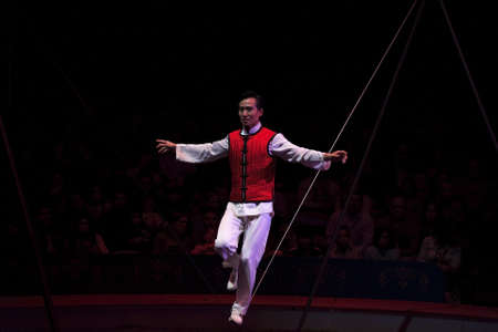 NEW YORK, NEW YORK - NOVEMBER 15: Man performs wire act at the Big Apple Circus show.  Taken November 15, 2007 in New York City.