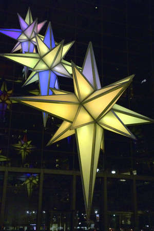 A light display hangs from the ceiling of the Time Warner Building in New York City during Christmas season.  Building is located on Columbus Circle and 59th street in Manhattan.  December 24th, 2006.