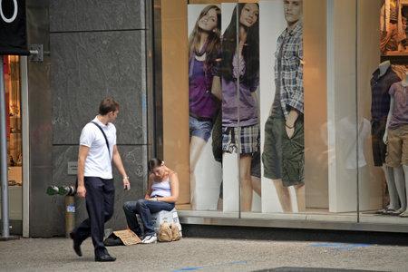 NEW YORK, NY - JUNE 08: homeless woman sitting on 60th street and Manhattan. Taken June 08, 2008 in New York City.