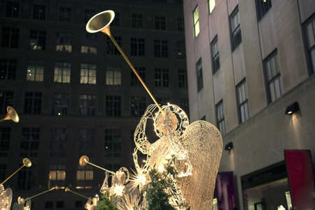 A wire sculpture of an angel sounding a trumpet.  Taken at Christmas in New York City, Rockefeller Center.
