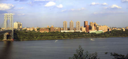 Pan photo of upper Manhattan and the George Washington Bridge viewed from Fort Lee, NJ.  River shown is the Hudson River.   Stock Photo - 10331817