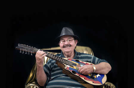 World legend and musician Yomo Toro.  Famous for playing the cuatro, a small guitar like instrument. Stock Photo - 10333285