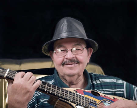 cuatro:   World legend and musician Yomo Toro.  Famous for playing the cuatro, a small guitar like instrument.
