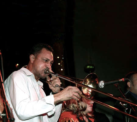 puerto rican: Musician playing trombone live in night club.  He is Puerto Rican.
