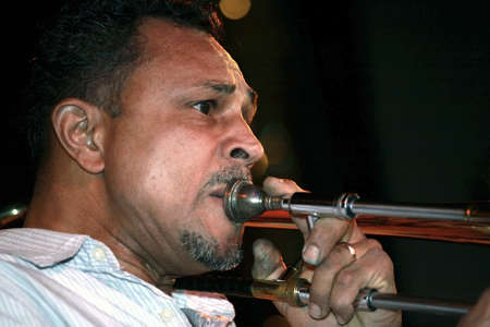 rican: Musician playing trombone live in night club.  He is Puerto Rican.