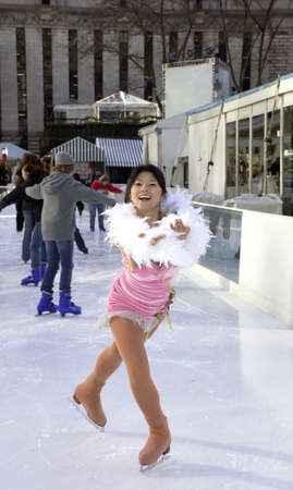 professional skater wearing outfit on ice. photo
