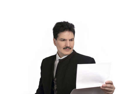 Man looking at notes wearing a Victorian suit with an unhappy expression.