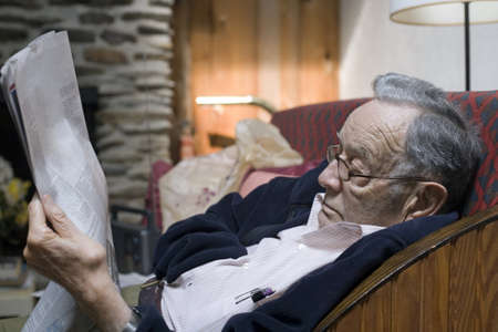 A senior man rests and reads his paper. Stock Photo - 11071965