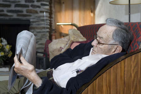 A senior man rests and reads his paper. Stock Photo - 11071967