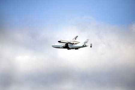 reuseable: NEW YORK, NY - April 27:  The Space Shuttle Enterprise rides on top of a jumbo 747 airplane. Photographed as the aircraft flew over Manhattan on their way to JFK airport. Taken Aprill 27, 2012 in NYC.