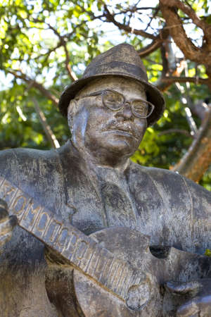 fania all stars: Guanica, PR - January 11:  Statue of legendary cuatro player Yomo Toro. Photographed January 11, 2011 in Puerto Rico.