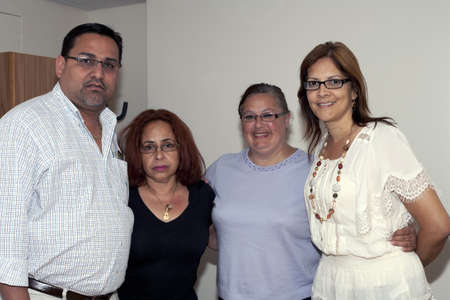 BRONX, NY - June 24: Mayor of Guanica Puerto Rico, daughter of Yomo Toro, wife and Marlyn Rodriguez Velazquez during visit to Yomo at hospital while his health was failing.