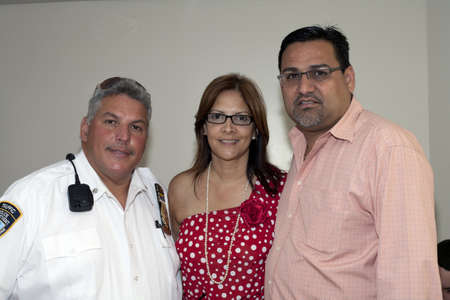 BRONX, NY - June 24:  Mayor of Guanica  Puerto Rico, Mart�n Vargas Morales, President of the popular Democratic party Marlyn Rodr�guez Vel�zquez and Julio Toro, nephew of legendary cuatro player Yomo Toro sit in the waiting area during their visit to Yomo
