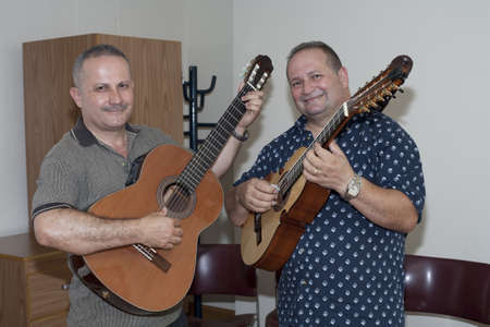 fania all stars: BRONX, NY - June 24: veteran cuatro players Bill and Edwin Colon Zayas in waiting area during their visit to legendary cuatro player Yomo Toro at the Hospital. Yomo Editorial