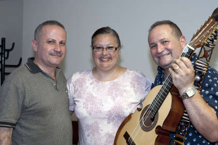 fania all stars: BRONX, NY - June 24: veteran cuatro players Bill and Edwin Colon Zayas stand with Minerva, wife of legendary cuatro player Yomo Toro in the waiting area during their visit to Yomo at Hospital. Yomo Editorial