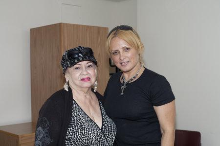 fania all stars: BRONX, NY - June 24:  veteran Bolero singer Blanca Iris Villafane and radio speaker Mayra Roman in a waiting area during their visit to legendary cuatro player Yomo Toro at Hospital. Yomo
