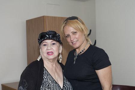 cuatro: BRONX, NY - June 24:  veteran Bolero singer Blanca Iris Villafane and radio speaker Mayra Roman in the waiting area during their visit to legendary cuatro player Yomo Toro at the Hospital. Yomo