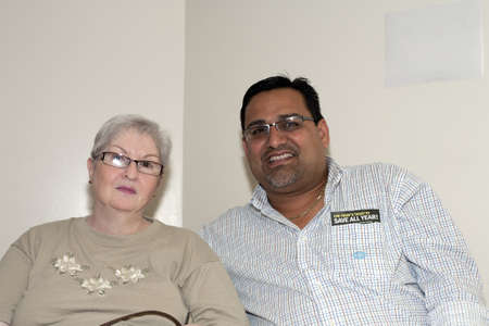 BRONX, NY - June 24:  Mayor of Guanica  Puerto Rico, Martín Vargas Morales and Lydia, sister of legendary cuatro player Yomo Toro in the waiting area during their visit to Yomo at Hospital. He has since expired. Photographed June 24, 2012 in NYC.