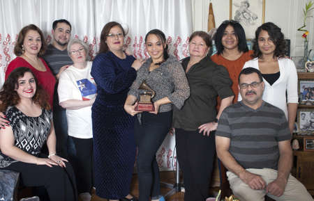fania all stars: BRONX, NEW YORK - DECEMBER 23: Yomo Toros family unites to remember international cuatro player Yomo Toro who was awarded the Grammy but passed away before he could accept it. Taken December 23, 2012 in the Bronx, NY. Editorial