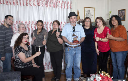 BRONX, NEW YORK - DECEMBER 23: Yomo Toro's family unites to remember and pray for international cuatro player Yomo Toro who was awarded the Grammy but passed away before he could accept it. Taken December 23, 2012 in the Bronx, NY. Stock Photo - 17262511
