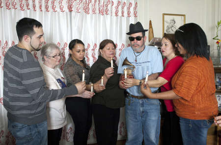 BRONX, NEW YORK - DECEMBER 23: Yomo Toros family unites in prayer to remember international cuatro player Yomo Toro who was awarded the Grammy but passed away before he could accept it. Taken December 23, 2012 in the Bronx, NY.