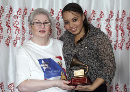 BRONX, NEW YORK - DECEMBER 23: : Yomo Toros sister Lydia on left and adopted daughter of music Katiria hold  Latin Grammy in honor of international cuatro player Yomo Toro who was awarded the Grammy but passed away before he could accept it. Taken Decemb
