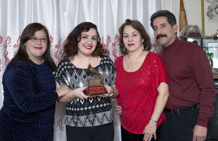 BRONX, NEW YORK - DECEMBER 23: Yomos wife Minerva, his niece Christina, niece Liz and her husband Andy remember Latin Grammy winner and international cuatro player Yomo Toro who was awarded the Grammy but passed away before he could accept it. Taken Dece