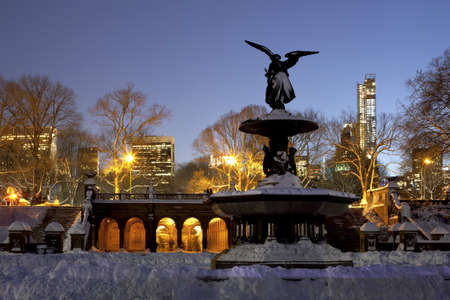 the fountain with angels: Bethesda Fountain in Central Park New York a day after snow storm Nemo  Editorial