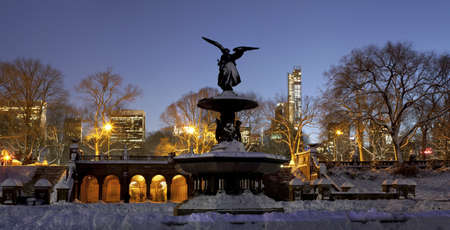 the fountain with angels: A Panoramic photo of Bethesda fountain located in Central Park New York City  Taken a day after snow storm Nemo fell on NYC