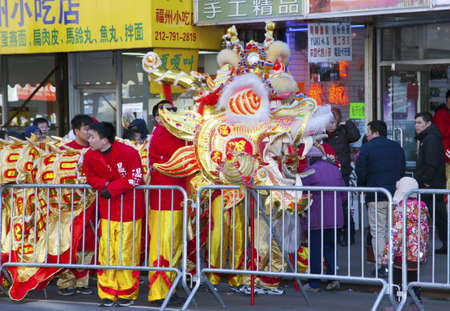 put away: NEW YORK, NEW YORK - FEBRUARY 17: Workers put away dragon costume after the Chinese New Year parade.   Taken FEBRUARY 17, 2013 in  NYC. Editorial