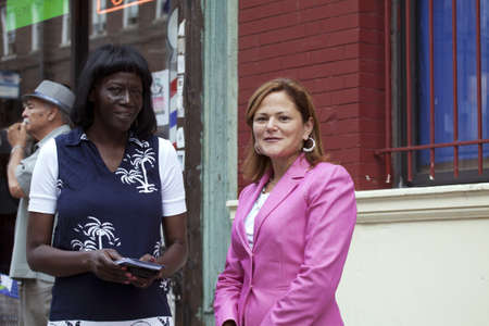 fania all stars: BRONX, NEW YORK - JULY 27  Council Member Melissa Mark-Viverito  right  with aide during street dedication for legendary musician Yomo Toro  Taken day of sign unveiling July 27, 2013 at Yomo Toro Place, Ogden avenue, in New York